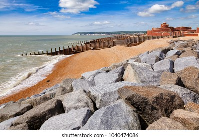Groynes and stone breakwater along the Eastbourne shingle beach, Sussex, South East England, UK