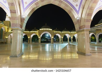 Grozny, Chechen Republic, Russia - June 01, 2019: Summer gallery and the square of one of the largest mosques in the world - the Heart of Chechnya mosque. A popular attraction of the night. Nobody