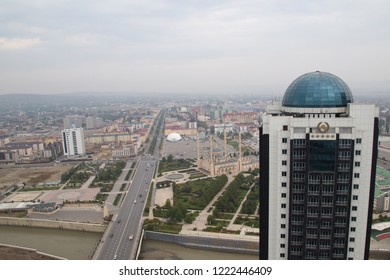 Grozny, Russia: 10.07.2015. Daily life in Chechen Republic. Aerieal view of skyscraper Hotel Grozny-City, Vladimir Putin Avenue and mosque Heart of Chechnya
