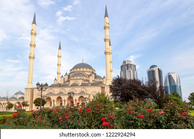 Grozny, Russia: 10.07.2015. Daily life in Chechen Republic. Main mosque of the Chechen Republic - Akhmad Kadyrov Mosque (Heart of Chechnya) and and skyscrapers of Grozny-city