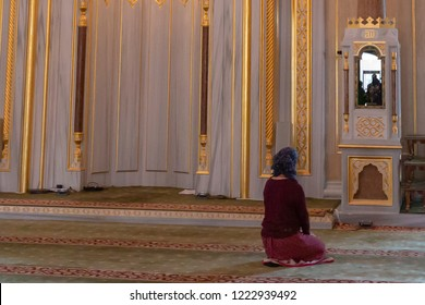 Grozny, Russia: 10.07.2015. Daily life in Chechen Republic. Main mosque of the Chechen Republic - Akhmad Kadyrov Mosque (Heart of Chechnya). Young woman praying in a mosque