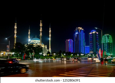 Grozny, Russia: 10.07.2015. Daily life in Chechen Republic. Skyscrapers of Grozny City with color lighting and Akhmad Kadyrov Mosque (Heart of Chechnya) in night