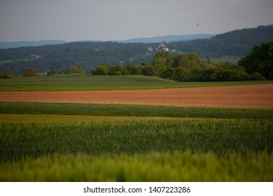 Grub, Bavaria, Germany. May 25, 2019. Beautiful evening sunlight across fields in Franconia, bavaria as the weather forecast warns of possible thunder and lightening storms overnight.