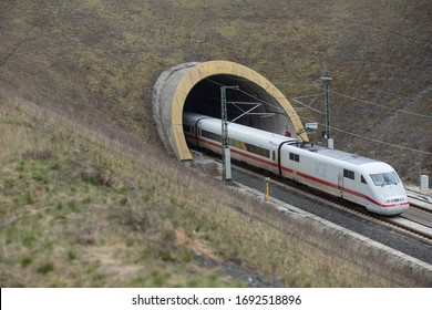 Grub am Forst, Germany. April 3, 2020. A high speed German train emerges from a tunnel in Bavaria as Deutsche Bahn suffers greatly due to the Corona crisis.