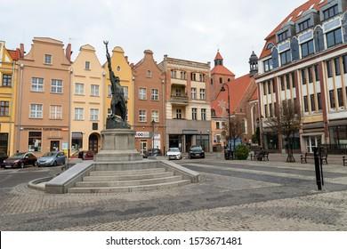 Grudziadz, kujawsko pomorskie / Poland – November, 28, 2019: Old town square on the Vistula. City center, monument and old tenements. Autumn season.