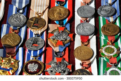 GRUDZIADZ, POLAND - JUNE 18 : Variety of antique medals for sale on the street market on June 18, 2015 in Grudziadz, Poland. On photo - antique medals of merit.
