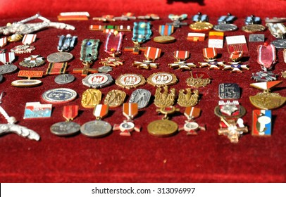 GRUDZIADZ, POLAND - JUNE 18 : Variety of antique medals for sale on the street market on June 18, 2015 in Grudziadz, Poland. On photo - antique medals and badges of the war and communism period.
