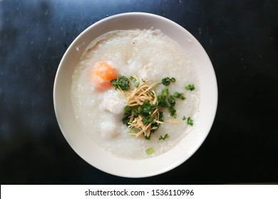 gruel or rice gruel or congee with egg ,pork and vegetable