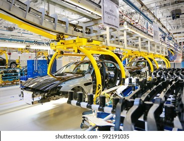 Grugliasco, Italy - June 30, 2014: car production line with unfinished cars in a row at Maserati factory.