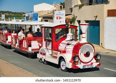 Gruissan, Aude, France - July 7 2019: Red tourist train in the village of gruissan
