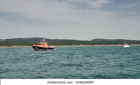 Gruissan, Aude/France - June 26 2019: Lifeboat SNS 202 Notre Dame des Auzils III in operation towing a sailboat just off Gruissan