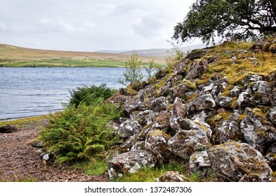 Grummore broch (site of ruins) and Loch Naver