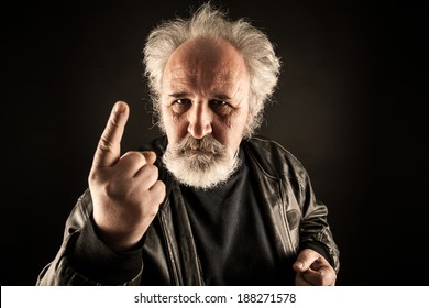Grumpy man against black background