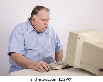 Grumpy old guy at computer
