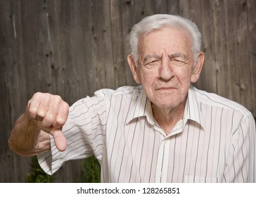 Grumpy old man giving thumbs down