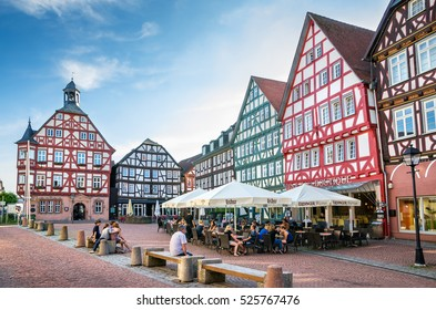 GRUNBERG, GERMANY - JUNE 7, 2011: Everyday life on the Market Square near Town Hall in the center of Grunberg.