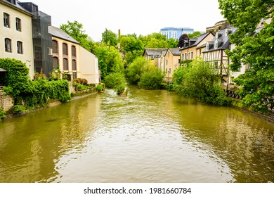 Grund, Luxembourg City, Luxembourg - May 26, 2021: The view from the Rue Munster bridge south up the river Alzette with riverside houses
