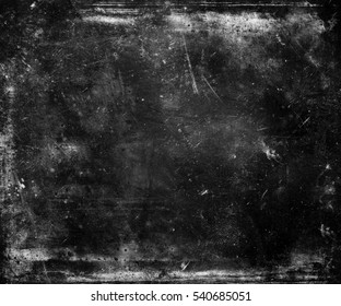 Grunge abstract scratched dark textured background with  frame