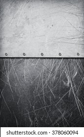 Grunge aluminum textured background with rivets and scratches