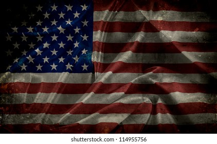 Grunge American flag backgrund with folds, creases and stains