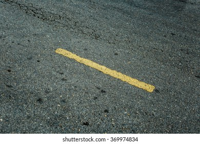 grunge asphalt road with yellow line, selective focus