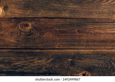 Grunge background of old brown wooden plank. Horizontal stripes