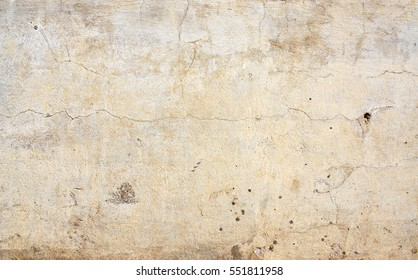 Grunge background with old stucco wall texture of beige color