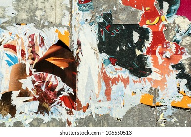 grunge background on billboard with old torn posters