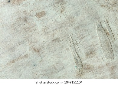 Grunge background. Peeling paint on an old wooden floor.