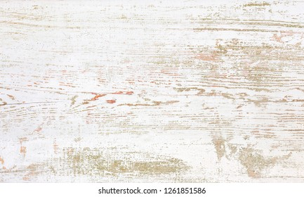 Grunge background. Peeling  paint on an old wooden floor. White wood texture for background.  Top view.
