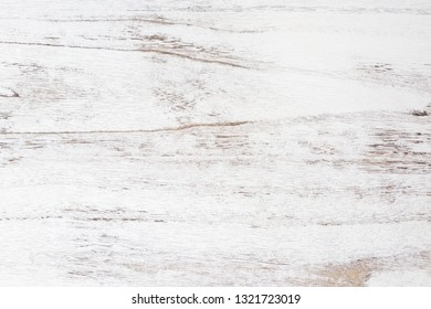 Grunge background. Peeling paint on an old wooden table. White wooden texture for background.