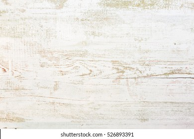 Grunge background. Peeling paint on an old wooden floor.