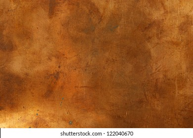 Grunge background from sheet metal of bronze