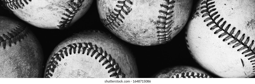 Grunge baseball banner with close up of old vintage balls as group in black and white.