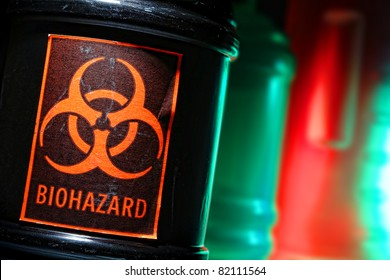 Grunge biohazard universal symbol danger warning label on a dangerous toxic waste black container in a scary hazardous material disposal site