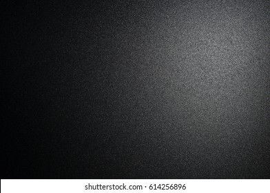 Grunge black color texture with light. Blackboard glitter and gradient color design or abstract background.