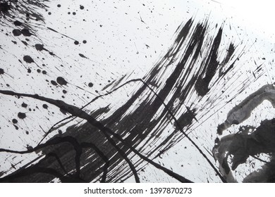 grunge black ink Blotches and splats on white paper