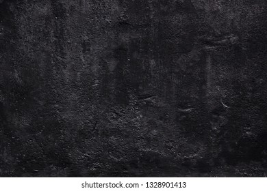 Grunge black paint industrial concrete wall background.