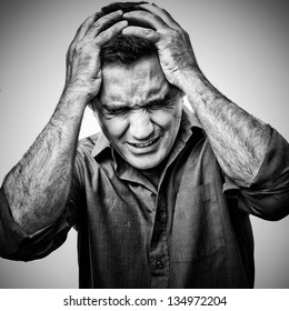 Grunge black and white  image of an angry man in pain
