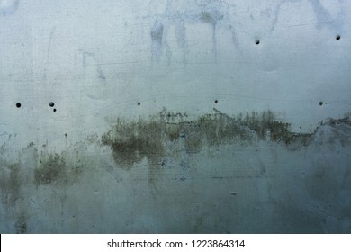 Grunge blue-gray metal sheet with rivets and mouldy dirt staining