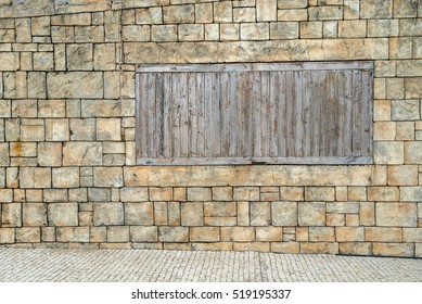 grunge brick wall with wooden window using as background