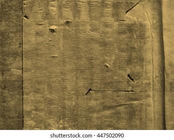 Grunge brown corrugated cardboard useful as a background vintage sepia