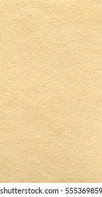 Grunge brown paper texture useful as a background - vertical