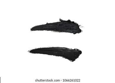 Grunge brush stroke isolated on white background. Realistic black mascara smudge, cosmetics elements concept.