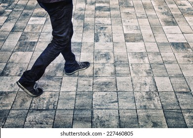 Grunge city walking background with man feet.