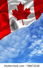 Grunge colorful flag Canada, with copyspace for your text or images against a blue sky with clouds