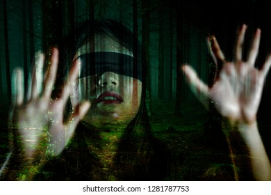 grunge composite of young scared and blindfolded Asian Korean teenager girl lost in dark forest confused playing dangerous internet viral challenge in horror movie dramatic style