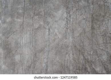 Grunge concrete wall with crack and stains in industrial building. Cement texture for design and background.