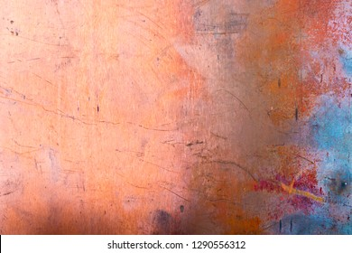 Grunge copper background with colored stains of chemical compounds