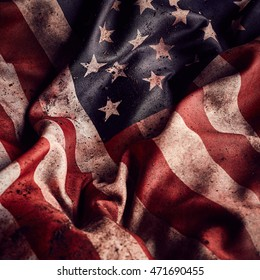 Grunge creased american flag background with dirt and blood